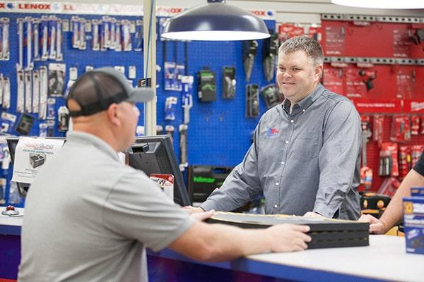 RHI Supply sales team member helping customer.