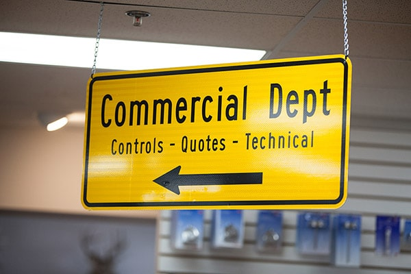 RHI Supply yellow sign for HVAC wholesale commercial department.