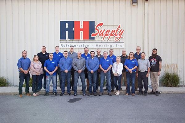RHI Supply team standing near RHI Supply building.